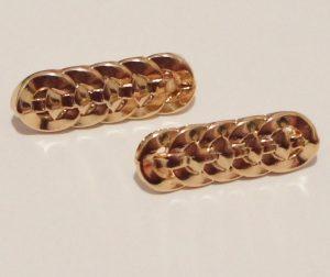 Auksinės metalinės sagos